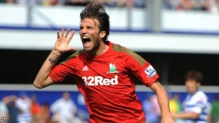 Michu celebrating for Swansea